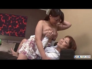 Shorthaired Girl Kissing Rubbing Busty Girl Tits On The Couch In The Room