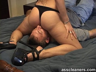 Mistress in heels and bikini sits her nice ass on mans face