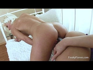 Horny lesbian sluts please each other with fingers, tounges and a huge ass black dildo