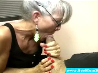 Mature wife with spex sucking cock
