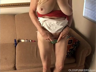 Trashy old spunker thinks of you as she fucks her juicy pussy